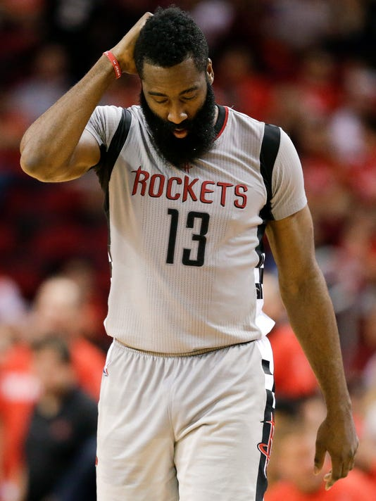 Houston Rockets guard James Harden walks the court late in the fourth quarter in Game 6 of the team's NBA basketball second-round playoff series against the San Antonio Spurs, Thursday, May 11, 2017, in Houston. San Antonio won 114-75. (AP Photo/Eric Christian Smith)