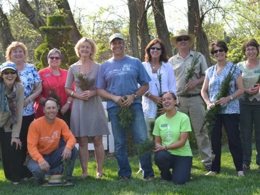Mike Rowe, seen here wearing the blue shirt (center), will feature Ladew Gardens on his show this Sunday.