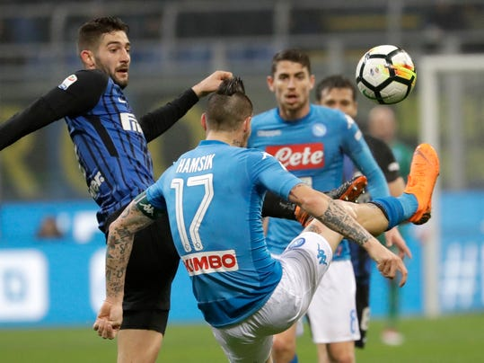 Inter Milan's Roberto Gagliardini, left, and Napoli's Marek Hamsik, back to camera, vie for the ball during a Serie A soccer match between Inter Milan and Napoli, at the San Siro stadium, in Milan, Sunday, March 11, 2018. (AP Photo/Luca Bruno)