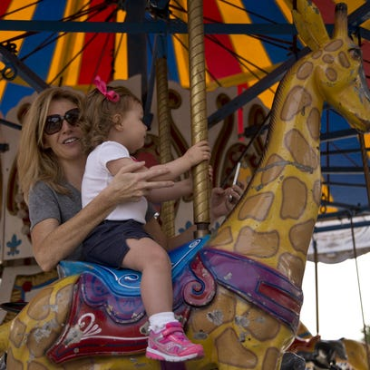 Fall for Greenville_Audrey(L) and Annabell Wilczewskienjoying a ride on the marr