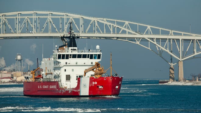 U.S. Coast Guard Cutter Mackinaw travels down the St. Clair River Friday, Jan. 23 in Port Huron. The Mackinaw will assist in ice breaking efforts this weekend in the St. Clair River's North Channel near Harsens Island.