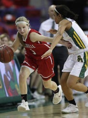 Hortonville High School's Shay Frederick (5) brings