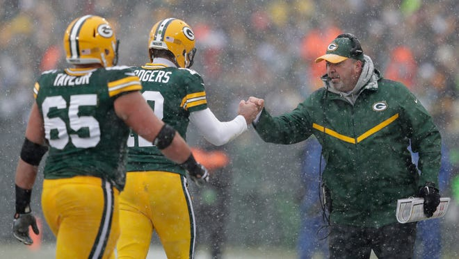 Green Bay Packers' Aaron Rodgers fist pumps coach Mike McCarthy after thowing a touchdown pass Randall Cobb.  The Green Bay Packers host the Houston Texans Monday, December 5, 2016, at Lambeau Field in Green Bay, Wis.