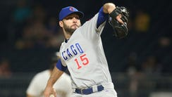 Chicago Cubs relief pitcher Brandon Morrow (15) pitches