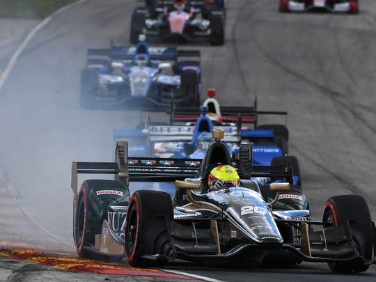 Jun 25, 2017; Elkhart Lake, WI, USA; Verizon IndyCar Series driver Spencer Pigot (20) goes off the track during the Kohler Grand Prix at Road America.
