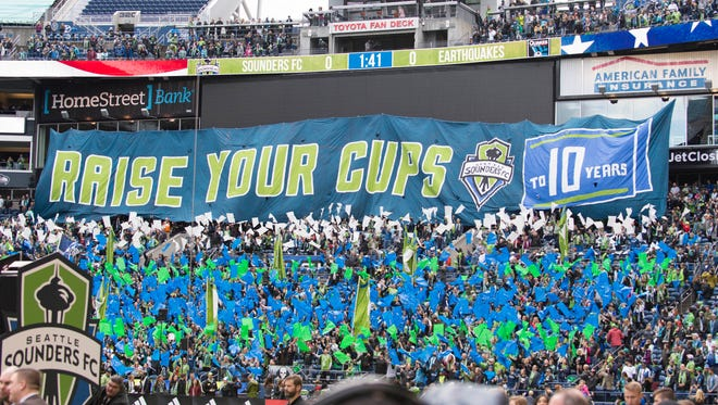Oct. 28, 2018: Seattle Sounders supports hold up a banner during the first half at CenturyLink Field.