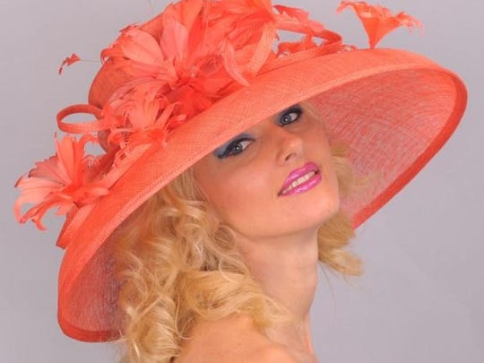 Hat designer DeLaine often stocks her shelves with colors such as this orange. Fuchsia, peacock blue and yellow are also often offered for those who want to make a statement. Lace, flowers, felt, pearls, crinoline or horsehair are also often used in the Derby hats.