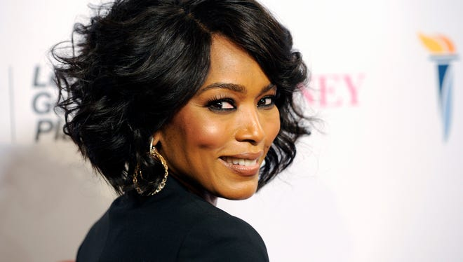 """Actress Angela Bassett, making her directorial debut with the Lifetime film """"Whitney,"""" turns back for photographers at the premiere of the film at the Paley Center for Media on Tuesday, Jan 6, 2015, in Beverly Hills, California."""