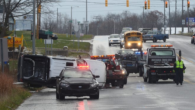 Scene of a rollover accident on Columbia Avenue just west of Main Street in Emmett Township on Thursday morning.