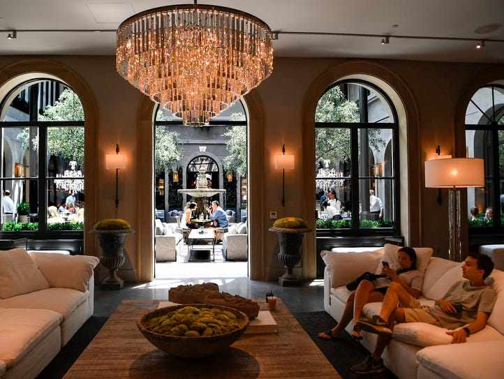 Chandeliers hang throughout the four levels of the