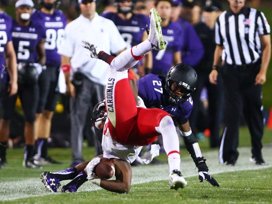 Ball State wide receiver Jordan Williams falls to the ground after making a catch last Saturday against Northwestern at Ryan Field.