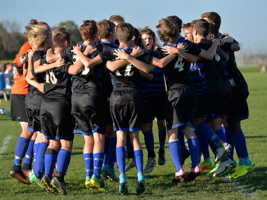 St. Cloud Cathedral's soccer team gets fired up before the start of the the first half of their game against Sauk Rapids Monday, Oct. 3, at Sauk Rapids-Rice High School.