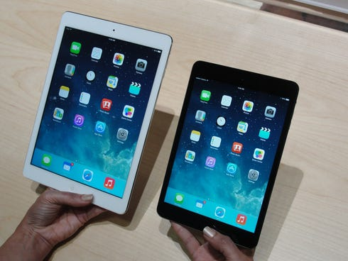 Apple's new iPad Air, left, and iPad mini tablets are displayed at an event in San Francisco.