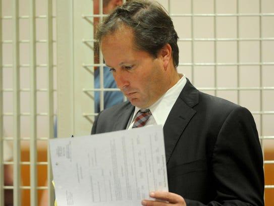 Senior Deputy Public Defender William Quest appears