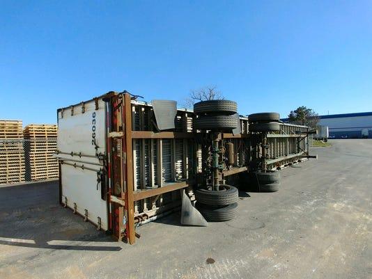 636245886367732994-toppled-truck.jpg