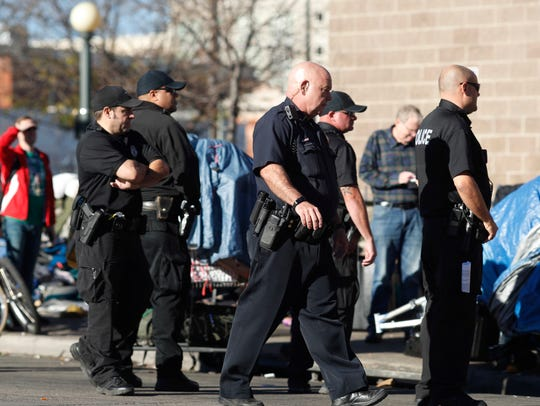 Denver Police Department officers keep watch during