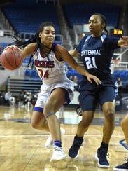 Reno's Kaitlynn Biassou dribbles the ball against Centennial's