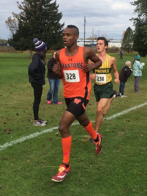 West De Pere sophomore Jermaine Hemauer competes in the WIAA Division 1 sectional race at Manitowoc Saturday. He became the school's first state qualifier from the boys team since 2004.