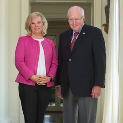 Cheney staffer Kara Ahern takes a photo of former vice president Dick Cheney, daughter Liz Cheney and Susan Page of USA TODAY at Dick Cheney's home in McLean, Va.