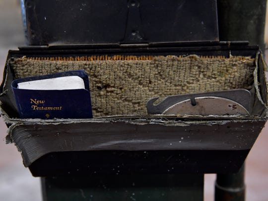 A pocket edition of the New Testament sits in a box with metal plates inside the engine bays at the former Central Fire Station. The city of Abilene held an open house for the building that is up for bid.