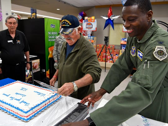 Bruce Griffin, who served with the U.S. Air Force in Vietnam from 1966-67, helps 7th Bomb Wing Commander Brandon Parker cut a cake honoring veterans from the Vietnam War in 2018.
