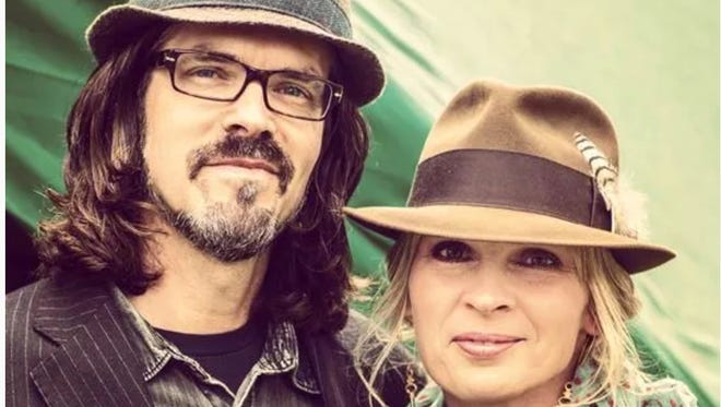 Husband and wife music makers behind the band Over the Rhine Linford Detweiler (left) and Karin Bergquist (right). The band will perform June 23 in Washington Park with donations to go to the United Way of Cincinnati.