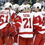 The Detroit Red Wings celebrate a goal by center Pavel Datsyuk (rear) against the Pittsburgh Penguins during the second period at the CONSOL Energy Center. The Red Wings won 2-1.