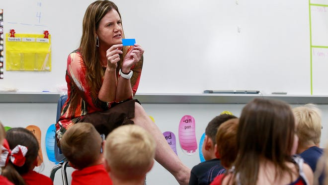 Phyllis Cox teaches her kindergarten class on Wednesday at Lydia Rippey Elementary School in Aztec. A popular after-school tutoring program in the Aztec district has been salvaged, thanks partly to a donation by an anonymous foundation.