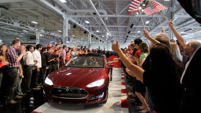 Tesla workers cheer on the first Tesla Model S cars sold during a rally at the Tesla factory in Fremont, Calif., in 2012. The  high-tech electric cars sell for more than $60,000 each. American workers sometimes lag behind their foreign counterparts in certain basic skills such as math and problem-solving.