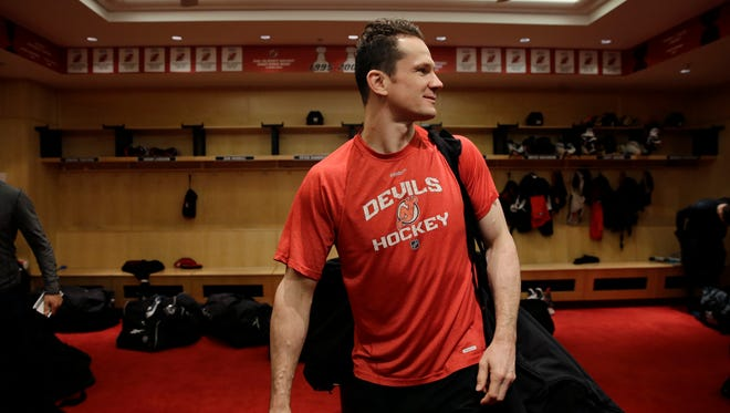 FILE - In this April 13, 2015, file photo, New Jersey Devils center Patrik Elias, of Czech Republic. carries his equipment bag as he leaves the locker room in Newark, N.J. Devils' all-time leading scorer Patrik Elias is retiring after a career that spanned almost two decades and included two Stanley Cup titles. The 40-year-old native of the Czech Republic announced his retirement in a statement on Friday, March 31, 2017. (AP Photo/Mel Evans, File)