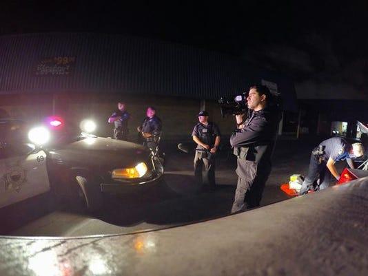 635839754801441264-Cops-filming.JPG