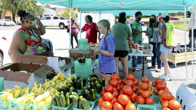 Customers pour in for the first Pop-Up Farmers Market at the McDonald Hughes Center in Tuscaloosa Monday, July 13, 2020.