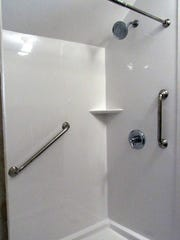 A new shower in the couple's upstairs bathroom should