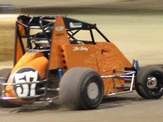 Lindsay Barney pulls away to win the 600 micro main event at the Salem Indoor on Saturday, Dec. 5, 2015.
