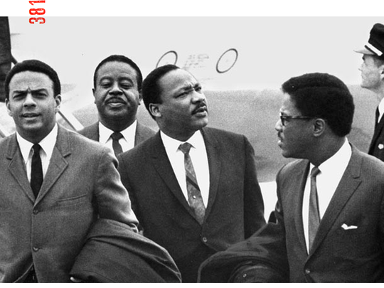 Dr. Martin Luther King Jr. arrives at the Memphis airport with aides (from left) Andrew Young, Ralph Abernathy and Bernard Lee on Wednesday, April 3, 1968.