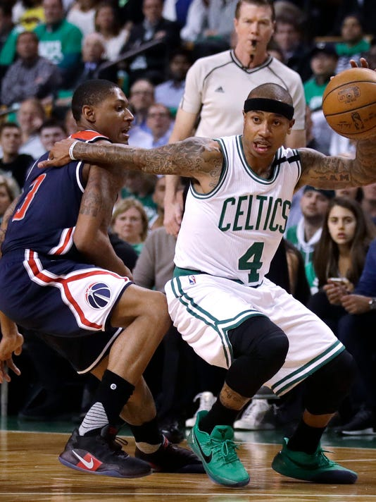 File-This may 10, 2017, file photo shows Boston Celtics guard Isaiah Thomas (4) driving to the basket during the first quarter of a second-round NBA playoff series basketball game in Boston.  Following the biggest slight of his NBA career, Thomas will have to prove his worth again. All eyes will be watching how he rebounds after Tuesday's blockbuster trade. The Celtics sent the two-time All-Star packing from a franchise and city that he'd embraced with every ounce of his 5-foot-9 frame. He's now bound for Cleveland in exchange for what the Celtics believe is a bigger star, and better point guard, in Kyrie Irving. (AP Photo/Charles Krupa, File)