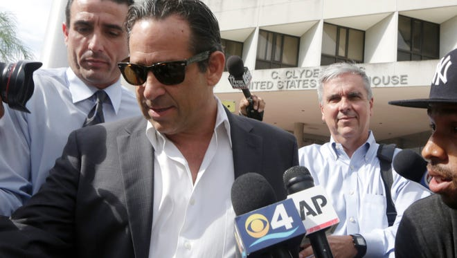 Anthony Bosch leaves the federal courthouse in Miami after paying bond on Aug. 5, 2014.
