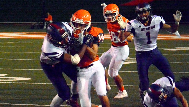 Artesia's Ryan Gallegos fights for extra yards in the second quarter Friday.