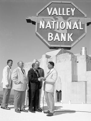Valley National Bank Sign atop the Professional Building at the sign dedication ceremony in April 1958. The sign dedication The included Valley Bank Property Manager Warren Kyle (from left), an unnamed person, Art Myers of Leiber & Myers, Bill Leiber (in background) and Valley Bank Executive Vice President James E. Patrick.