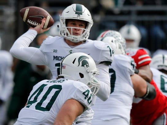 Fullback Collin Lucas (40) looks to block for Michigan State quarterback Brian Lewerke at Ohio State last season.