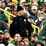 A shirtless fan is chased through the stands of Lambeau Field when the Green Bay Packers hosted the New York Jets last season. The man was arrested on a charge of unlawful conduct at a public event.