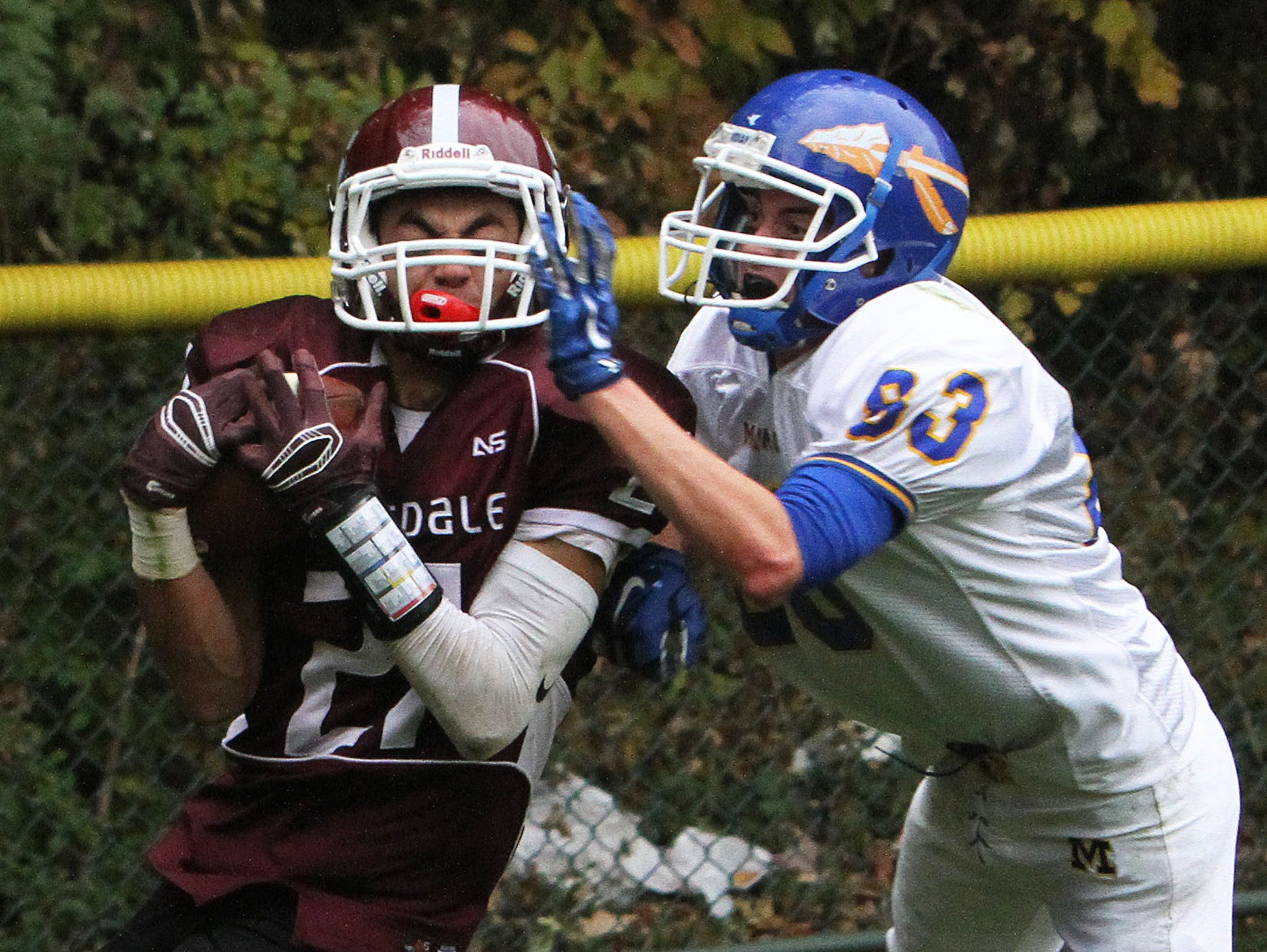 Scarsdale's Sam Squadron (21) catches the game winning touchdown pass in front of Mahopac's Shane Mcdonald (83) during football playoff game at Scarsdale High School Oct. 24, 2015. Scarsdale won the game 33-28.