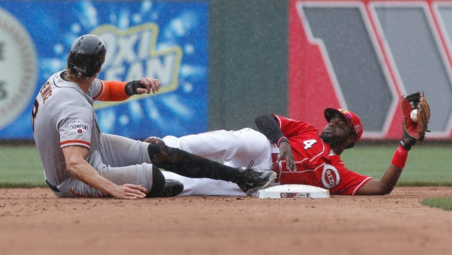San Francisco Giants right fielder Hunter Pence (8) is called safe at second next to Cincinnati Reds second baseman Brandon Phillips (4).