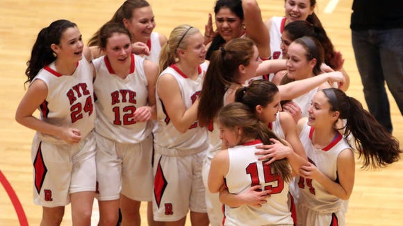 Rye players celebrate their 37-31 victory over Pearl River in the girls Class A semifinal at the Westchester County Center in White Plains Feb. 24, 2016. Rye won the game 37-31.
