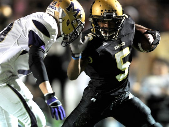 Abilene High running back Paxton Grayer (5) shoves
