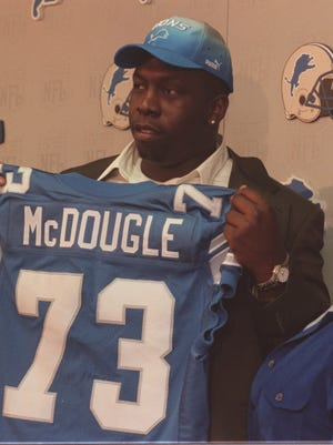 Here's a look at the Detroit Lions' top draft picks this century, starting with Oklahoma tackle Stockar McDougle, who went No. 20 overall in 2000.