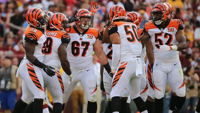 Cincinnati Bengals defensive tackle Ryan Glasgow (67), center, is congratulated after making a tackle for a loss in the third quarter during the Week 3 NFL preseason game between the Cincinnati Bengals and Washington, Sunday, Aug. 27, 2017, at FedEx Field in Landover, Maryland.