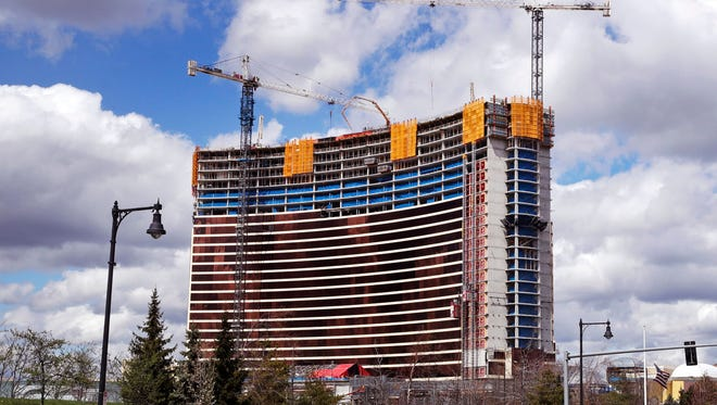 Construction cranes tower over the Wynn Resorts casino site in Everett, Mass., Thursday, April 26, 2018. Massachusetts gambling regulators consider Wynn Resorts' request to remove the name of company founder Steve Wynn, who faces numerous allegations of sexual misconduct, from its state casino license.