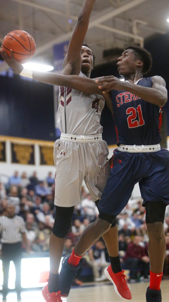 Stepinac's Adrian Griffin Jr. (21) shoots while being