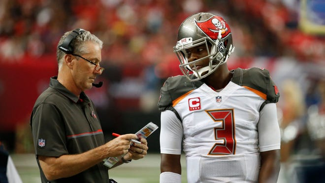 Sept. 11, 2016; Atlanta; Tampa Bay Buccaneers head coach Dirk Koetter talks with quarterback Jameis Winston (3) in the fourth quarter of their game against the Atlanta Falcons at the Georgia Dome. The Buccaneers won 31-24.